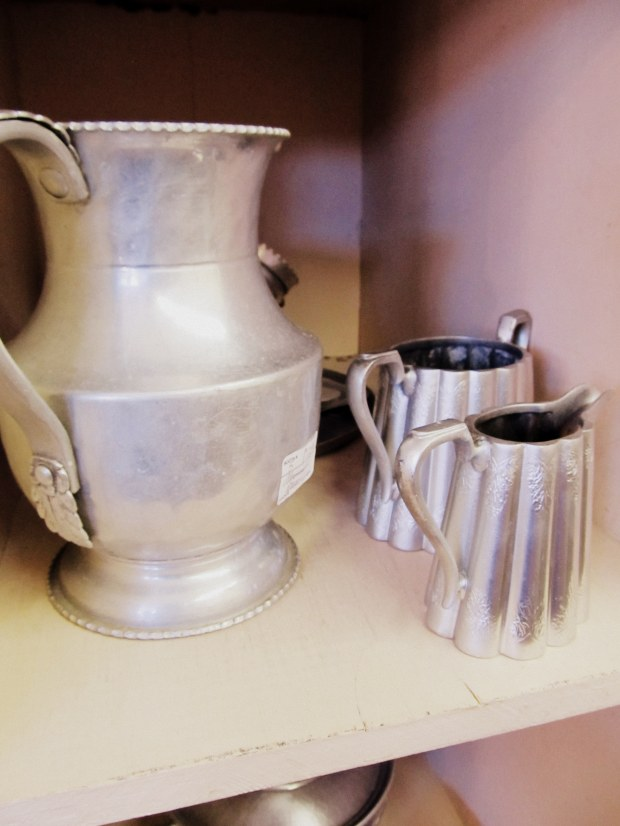 metal pitcher and cups